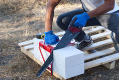Cutting aerated concrete Royalty Free Stock Photography