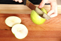 Cutting a Apple Royalty Free Stock Photos