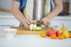 Cutting apple on cutting board Stock Photography