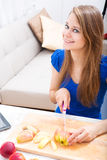 Cutting apple while getting online information about nutrition Stock Photo