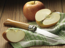 Cutting and apple with an Opinel Stock Image