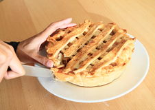 Cutting apple pie Royalty Free Stock Photo