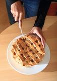 Cutting apple pie Stock Photography