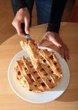 Cutting apple pie Stock Photos