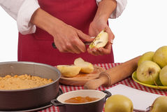 Cutting apples for a pie Stock Photography