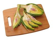 Cutting artichoke Royalty Free Stock Image