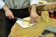 Cutting a big piece of cheese royalty free stock photo
