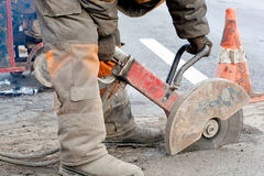 Cutting asphalt road for repairing Stock Image