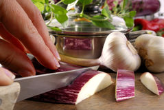 Cutting aubergine. On a kitchen board Stock Photography