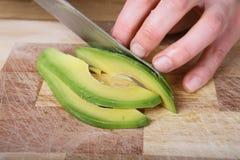 Cutting the avocado Stock Photos