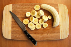 Cutting bananas Royalty Free Stock Images
