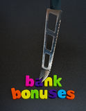 Cutting bank bonuses. royalty free stock image