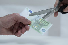 Cutting banknote Royalty Free Stock Photos
