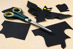 Cutting bat out of black paper Royalty Free Stock Images