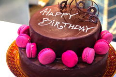 Cutting the beautifully decorated  a festive chocolate cake with the inscription Happy Birthday Royalty Free Stock Photos