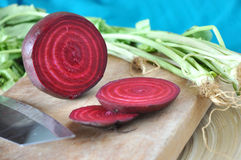 Cutting Beetroot on Wooden Board Royalty Free Stock Image