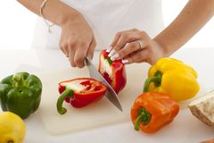 Cutting the bell pepper Royalty Free Stock Photos