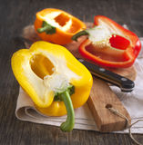 Cutting Bell Peppers on wooden chopping board Royalty Free Stock Image