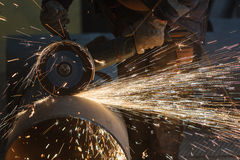 Cutting big pipe with grinder Stock Images