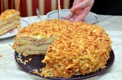 Cutting the birthday cake. Fresh layer cake Napoleon, with custard Stock Photos