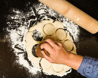 Cutting biscuits from rolled dough Royalty Free Stock Photos