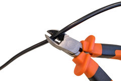 Cutting black wire by nippers, trimming the cable,  on white background. Cutting black wire by nippers, trimming the cable Stock Image