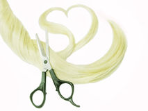 Cutting blond hair Royalty Free Stock Images