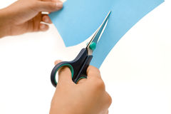 Cutting Blue Paper Royalty Free Stock Photo