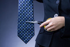 Cutting blue tie Stock Photo