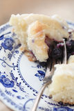 Cutting into a blueberry sweet roll Royalty Free Stock Photography