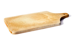 Cutting board. A wooden cutting board used to cut vegetables and meat Stock Images