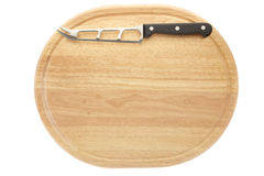 Cutting board. And cheese knife isolated on white, clipping path included Royalty Free Stock Photo