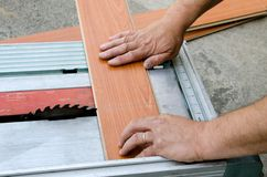 Cutting a board. Worker cutting a board on a table saw Stock Image