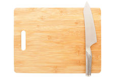 Cutting board background. Spotless cutting board and chef's knife with plenty of copy space Royalty Free Stock Photo