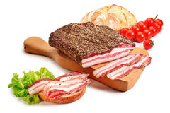 Cutting board with bacon and bread Stock Photo