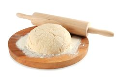 Cutting board with ball of raw dough and rolling pin. On white background Royalty Free Stock Photography