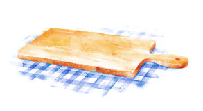 Cutting board on blue checkered tablecloth. Stock Image