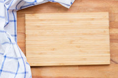 Cutting board and  blue  napkin Royalty Free Stock Photo