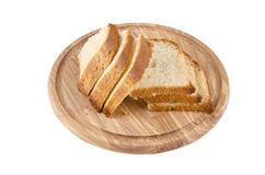 Cutting board with bread. On white baclground Royalty Free Stock Image