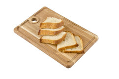 Cutting board with bread. On white baclground Royalty Free Stock Photo