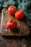 Cutting board with cherry tomatoes Royalty Free Stock Photography