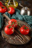 Cutting board with cherry tomatoes Stock Photo
