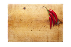 Cutting board with chillies. Wooden cutting board with chillies, top view Stock Photo