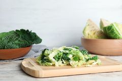 Cutting board with chopped savoy cabbage. On table stock photos