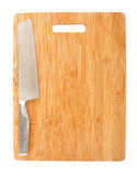 Cutting board and cleaver. Clean, empty cutting board and a sharp cleaver stock photography