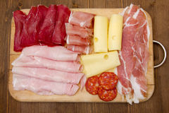Cutting board with cold cuts Stock Photo