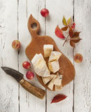 Cutting board with different kinds of cheeses Stock Photos