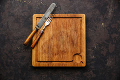 Cutting board and fork and knife set Royalty Free Stock Photo