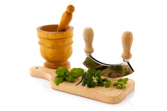 Cutting board with fresh herbs Royalty Free Stock Photos