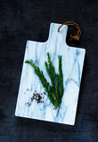 Cutting board and fresh rosemary Stock Photo